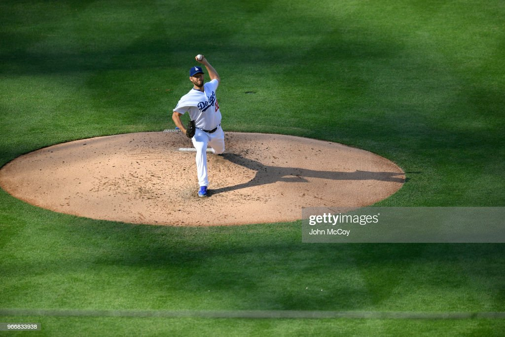Clayton Kershaw #22 of the Los Angeles Dodgers pitches against the Philadelphia Phillies in the third inning at Dodger Stadium on May 31, 2018 in Los Angeles, California.