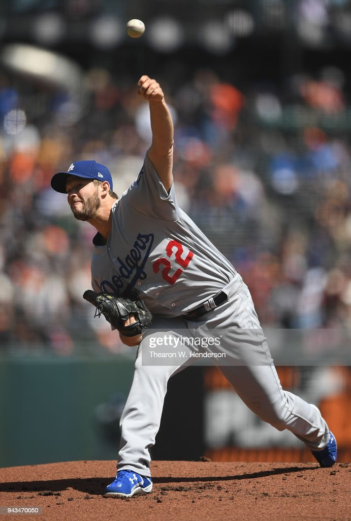Clayton Kershaw #22 of the Los Angeles Dodgers pitches against the San Francisco Giants in the bottom of the first inning at AT&T Park on April 8, 2018 in San Francisco, California.