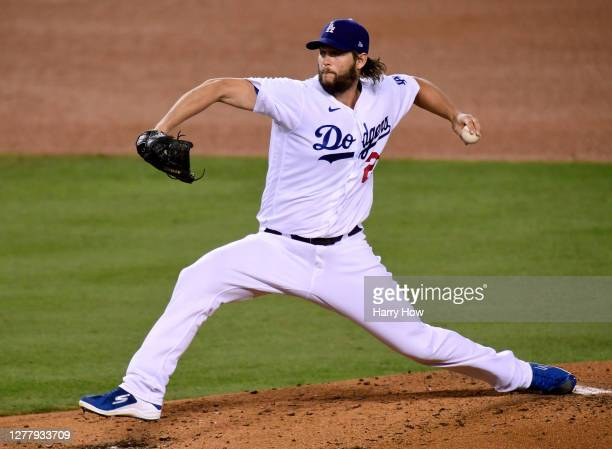 Clayton Kershaw of the Los Angeles Dodgers pitches against the Milwaukee Brewers during the third inning in game two of the National League Wild Card...