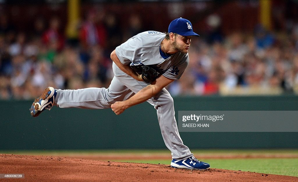 Clayton Kershaw of the Los Angeles Dodgers pitches at the start of the Major League Baseball (MLB) opening season game between the Los Angeles Dodgers and the Arizona Diamondbacks at the Sydney Cricket Ground in Sydney on March 22, 2014.