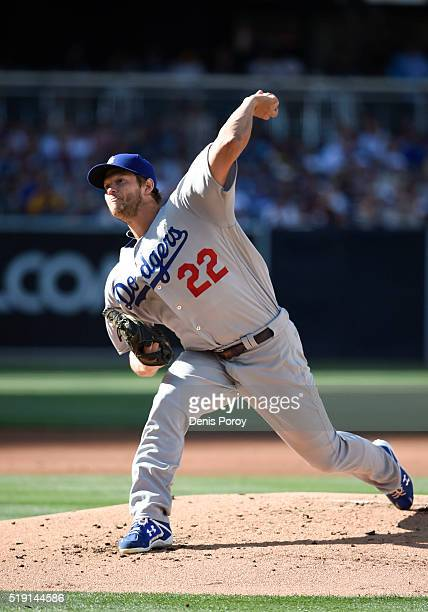Clayton Kershaw of the Los Angeles Dodgers pitches during the first inning of a baseball game against the San Diego Padres on opening day at PETCO...