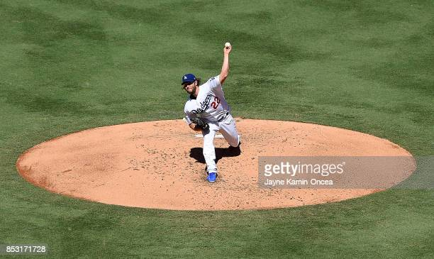 Clayton Kershaw of the Los Angeles Dodgers pitches in the third inning of the game against the San Francisco Giants at Dodger Stadium on September 24...