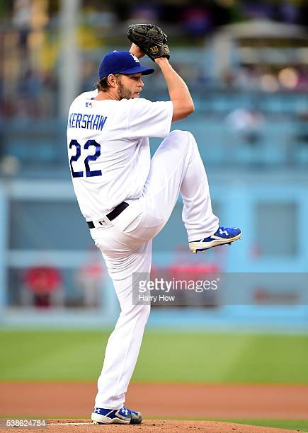 Clayton Kershaw of the Los Angeles Dodgers pitches to the Cincinnati Reds during the first inning at Dodger Stadium on May 23 2016 in Los Angeles...