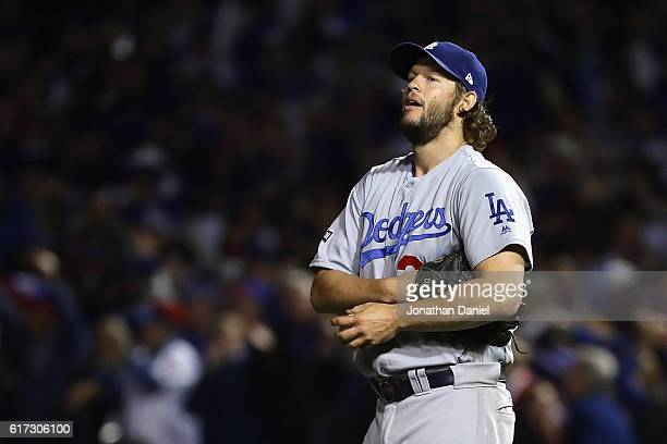 Clayton Kershaw of the Los Angeles Dodgers reacts after a solo home run by Anthony Rizzo of the Chicago Cubs in the fifth inning during game six of...