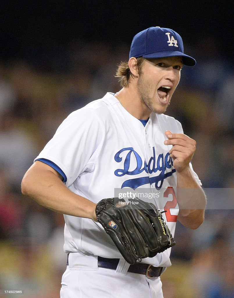 Clayton Kershaw #22 of the Los Angeles Dodgers reacts after a strike to Devin Mesoraco #39 of the Cincinnati Reds during the eighth inning at Dodger Stadium on July 26, 2013 in Los Angeles, California.