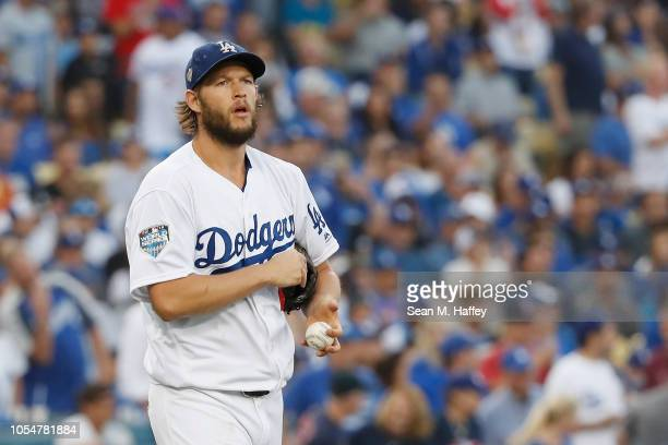 Clayton Kershaw of the Los Angeles Dodgers reacts after allowing a first inning home run against the Boston Red Sox in Game Five of the 2018 World...