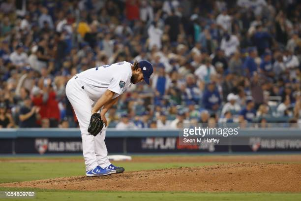 Clayton Kershaw of the Los Angeles Dodgers reacts after allowing a sixth inning home run to Mookie Betts of the Boston Red Sox in Game Five of the...