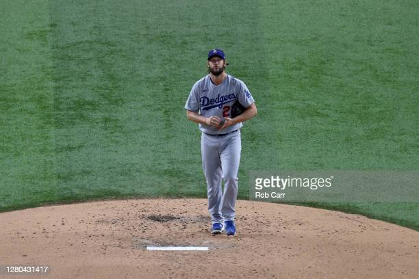 Clayton Kershaw of the Los Angeles Dodgers reacts after allowing a solo home run to Marcell Ozuna of the Atlanta Braves during the fourth inning in...