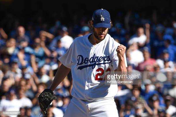 Clayton Kershaw of the Los Angeles Dodgers reacts after striking out Jesus Aguilar of the Milwaukee Brewers with the bases loaded during the third...