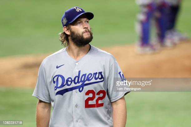 Clayton Kershaw of the Los Angeles Dodgers reacts as he is taken out of the game against the Tampa Bay Rays during the sixth inning in Game Five of...
