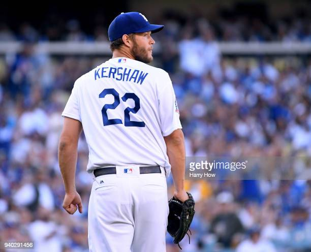 Clayton Kershaw of the Los Angeles Dodgers reacts as he watches the third out of the fourth inning against the San Francisco Giants during the 2018...
