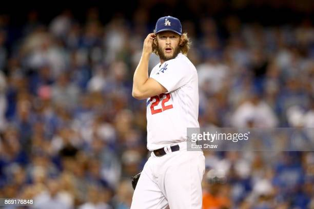 Clayton Kershaw of the Los Angeles Dodgers reacts during the third inning against the Houston Astros in game seven of the 2017 World Series at Dodger...