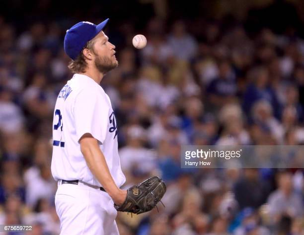 Clayton Kershaw of the Los Angeles Dodgers reacts to a solo homerun from Buster Posey of the San Francisco Giants to take a 32 lead during the third...