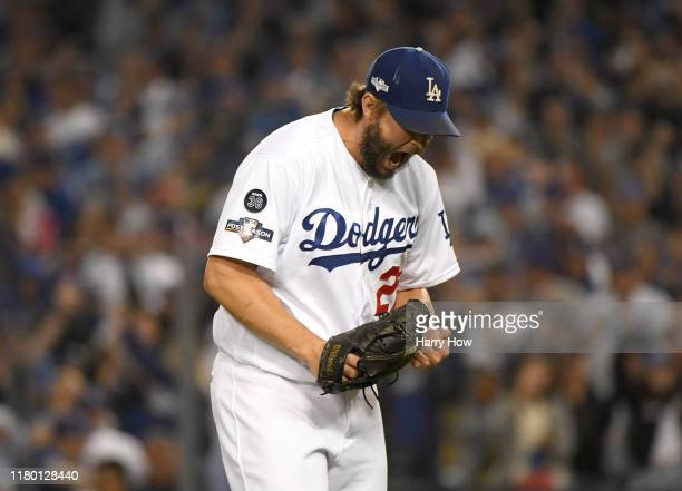 Clayton Kershaw of the Los Angeles Dodgers reacts to the third out of the seventh inning of game five of the National League Division Series against...