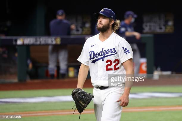 Clayton Kershaw of the Los Angeles Dodgers returns to the dugout after retiring the side against the Tampa Bay Rays during the fifth inning in Game...