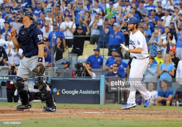 Clayton Kershaw of the Los Angeles Dodgers scores in the seventh inning of Game 5 of the NLCS against the Milwaukee Brewers at Dodger Stadium on...