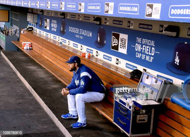 Clayton Kershaw of the Los Angeles Dodgers sits alone in the dugout before his start against the Colorado Rockies at Dodger Stadium on September 18,...