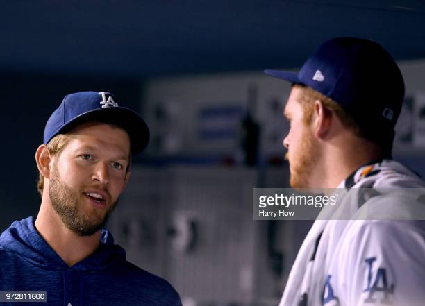 Clayton Kershaw of the Los Angeles Dodgers speaks with starting pitcher Caleb Ferguson in the dugout during the fourth inning with a 72 lead over the...