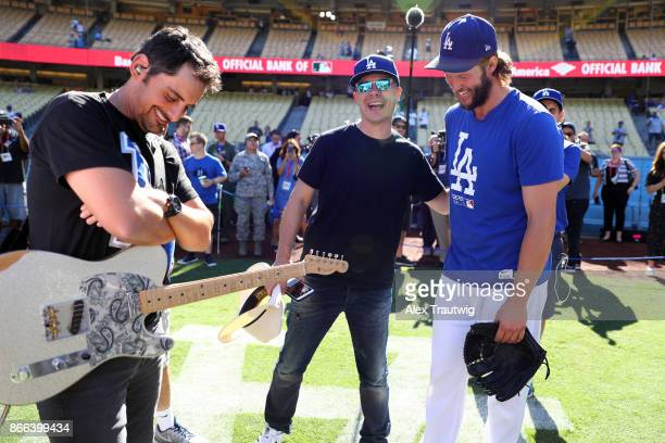 Clayton Kershaw of the Los Angeles Dodgers talks with Brad Paisley prior to Game 2 of the 2017 World Series against the Houston Astros at Dodger...