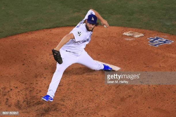 Clayton Kershaw of the Los Angeles Dodgers throws a pitch during the fourth inning against the Houston Astros in game seven of the 2017 World Series...