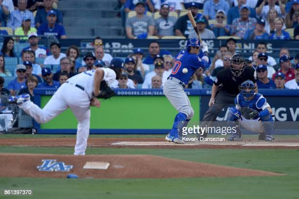 Clayton Kershaw of the Los Angeles Dodgers throws a pitch to Jon Jay of the Chicago Cubs during the first inning in Game One of the National League...