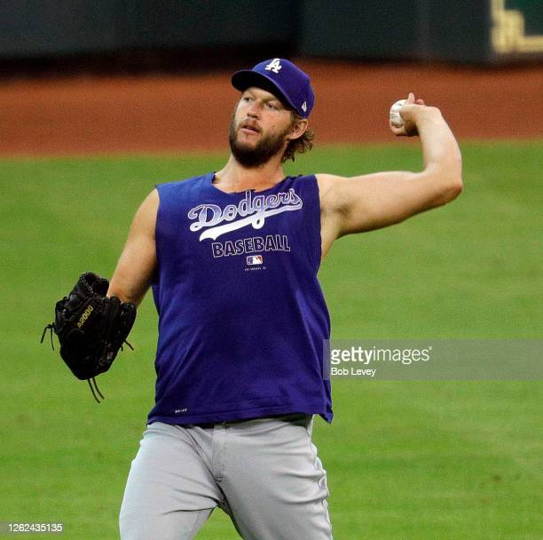 Clayton Kershaw of the Los Angeles Dodgers throws the ball at Minute Maid Park on July 29, 2020 in Houston, Texas. Kershaw is on the injured list...