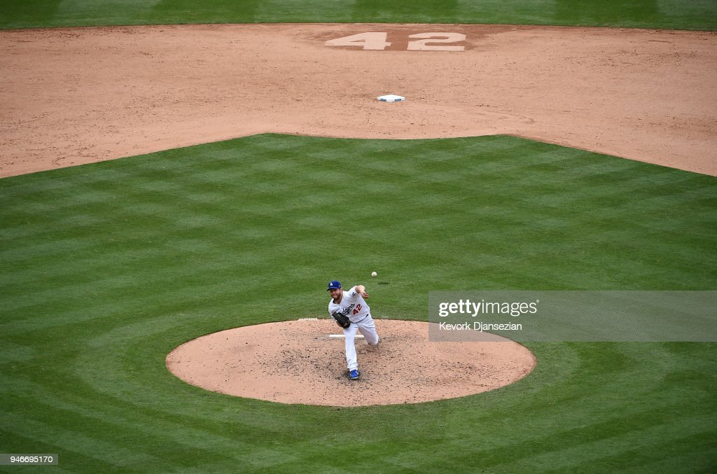 Clayton Kershaw #22 of the Los Angeles Dodgers throws to the plate during the fifth inning against Arizona Diamondbacks at Dodger Stadium on April 15, 2018 in Los Angeles, California. All players are wearing #42 in honor of Jackie Robinson Day.