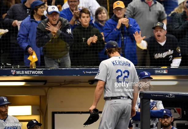 Clayton Kershaw of the Los Angeles Dodgers walks back to the dugout after being relieved by manager Dave Roberts against the Milwaukee Brewers during...