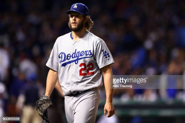 Clayton Kershaw of the Los Angeles Dodgers walks back to the dugout during Game 5 of the National League Championship Series against the Chicago Cubs...