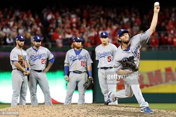 Clayton Kershaw of the Los Angeles Dodgers warms up after coming in during the ninth inning against the Washington Nationals during game five of the...