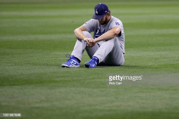 Clayton Kershaw of the Los Angeles Dodgers warms up prior to Game One of the National League Championship Series against the Milwaukee Brewers at...
