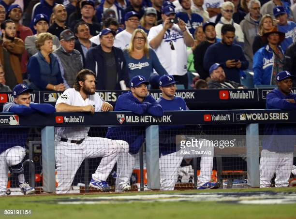 Clayton Kershaw of the Los Angeles Dodgers watches the action from the dugout during Game 7 of the 2017 World Series against the Houston Astros at...