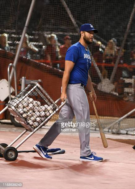 Clayton Kershaw of the Los Angeles Dodgers wheels the practice balls to the batting cage prior to a game against the Arizona Diamondbacks at Chase...