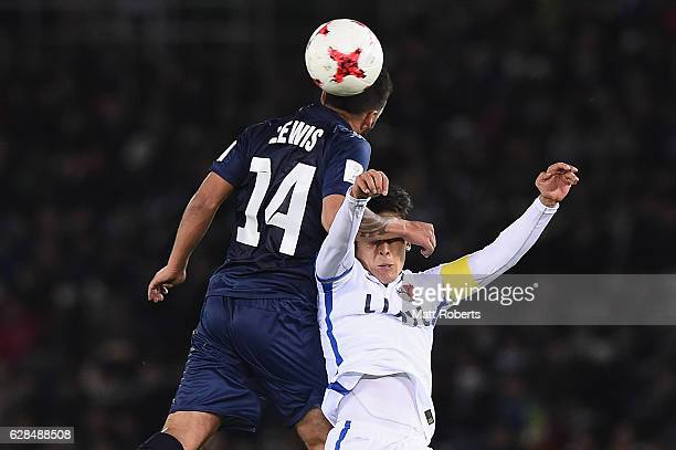 Clayton Lewis of Auckland City heads the ball over Ryota Nagaki of Kashima Antlers during the FIFA Club World Cup Playoff for Quarter Final match...