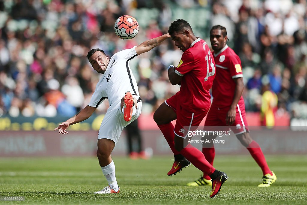 Clayton Lewis of New Zealand competes against Roy Kayara of New Caledonia during the 2018 FIFA World Cup Qualifier match between the New Zealand All Whites and New Caledonia at QBE Stadium on November 12, 2016 in Auckland, New Zealand.
