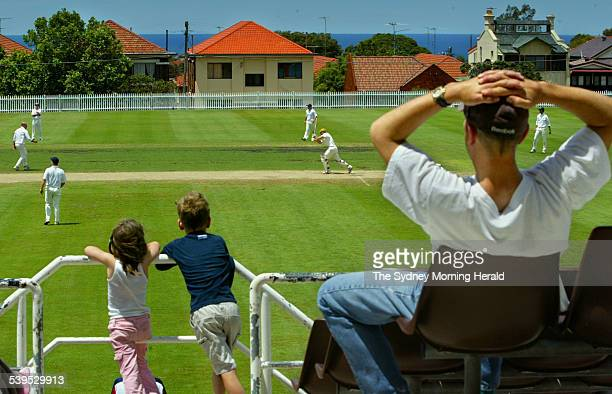 Clayton McBride and his sister Cordelia enjoying the cricket whilst their Dad Slide looks on during the A Grade cricket match between University of...