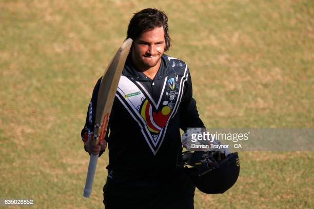 Clayton McCartney of Victoria raises his bat after being dismissed for 114 runs off 109 balls during the National Indigenous Cricket Championships...