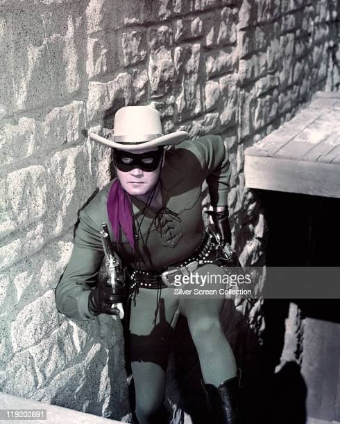Clayton Moore US actor holding a handgun in a publicity still issued for the television series 'The Lone Ranger' USA circa 1950 The adventure series...