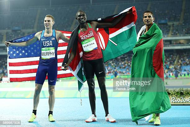 Clayton Murphy of the United States third place David Lekuta Rudisha of Kenya first place and Taoufik Makhloufi of Algeria second place celebrate...