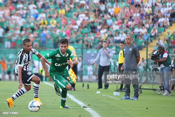 Clayton of Figueirense struggles for the ball with Jussandro of Chapecoense during a match between Figueirense and Chapecoense for the Brazilian...