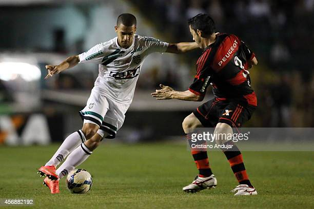 Clayton of Figueirense try to passes through Chicao of Flamengo during a match between Figueirense and Flamengo as part of Campeonato Brasileiro 2014...