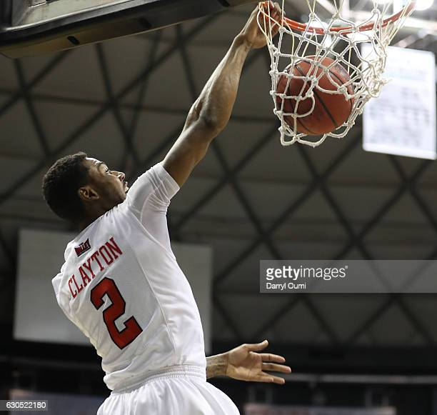 Clayton of the Illinois State Redbirds dunks the ball during the first half of the Diamond Head Classic third place game against the Tulsa Golden...
