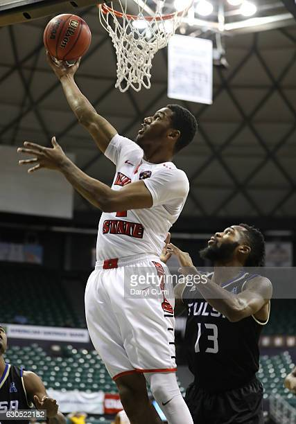Clayton of the Illinois State Redbirds gets around Jaleel Wheeler of the Tulsa Golden Hurricane and shoots the ball during the first half of the...