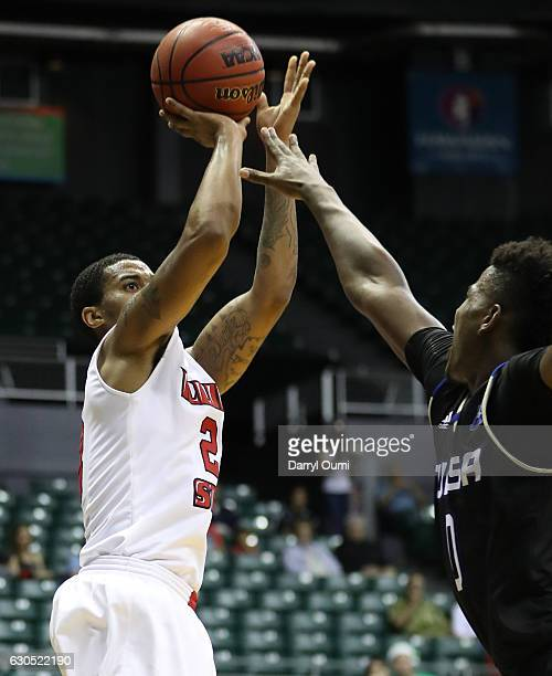 Clayton of the Illinois State Redbirds shoots over Junior Etou of the Tulsa Golden Hurricane during the first half of the Diamond Head Classic third...