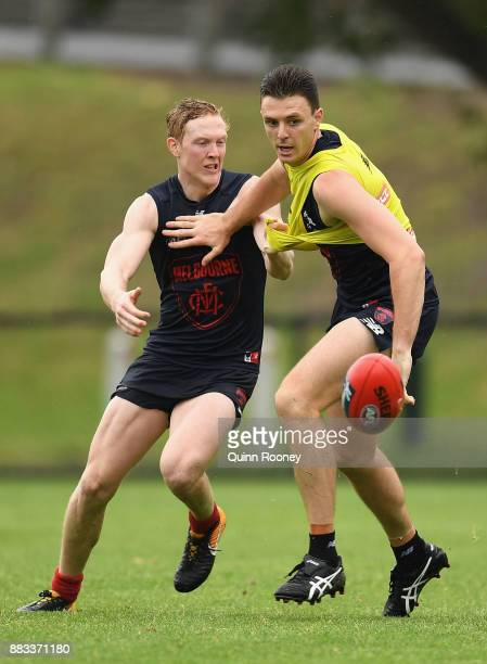 Clayton Oliver and Jake Lever of the Demons compete for the ball during a Melbourne Demons AFL training session at Gosch's Paddock on December 1 2017...