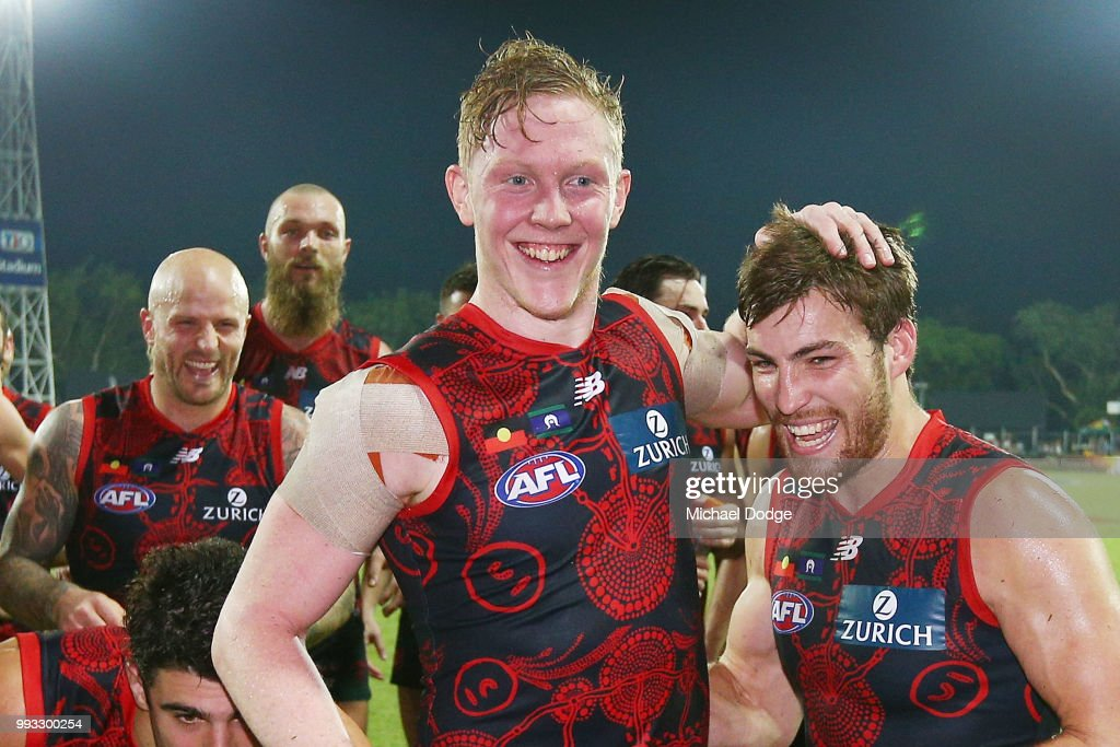 Clayton Oliver of the Demons (L) and Jack Viney of the Demons celebrate the win during the round 16 AFL match between the Melbourne Demons and the Fremantle Dockers at TIO Stadium on July 7, 2018 in Darwin, Australia.