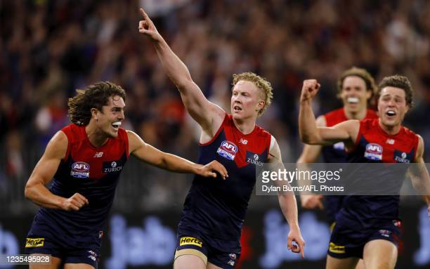 Clayton Oliver of the Demons celebrates a goal with Luke Jackson of the Demons during the 2021 Toyota AFL Grand Final match between the Melbourne...