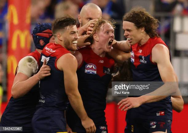 Clayton Oliver of the Demons celebrates after scoring a goal during the 2021 AFL Grand Final match between the Melbourne Demons and the Western...