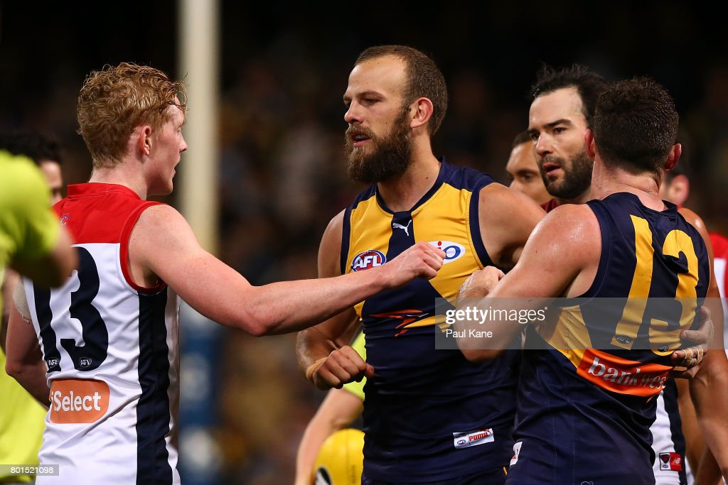 Clayton Oliver of the Demons confronts Will Schofield and Luke Shuey of the Eagles as players become involved in an altercation at the end of the second quarter during the round 14 AFL match between the West Coast Eagles and the Melbourne Demons at Domain Stadium on June 24, 2017 in Perth, Australia.