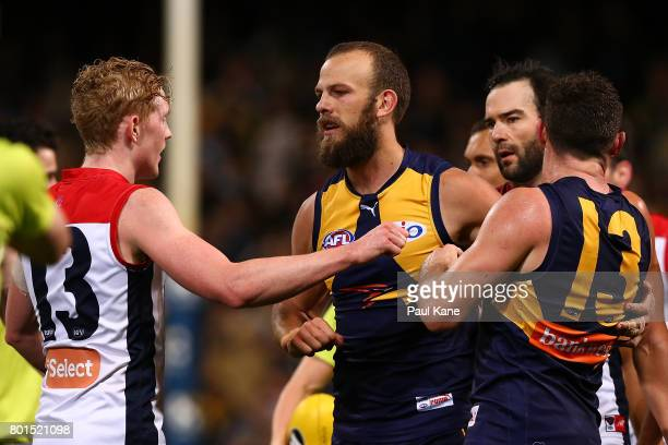 Clayton Oliver of the Demons confronts Will Schofield and Luke Shuey of the Eagles as players become involved in an altercation at the end of the...